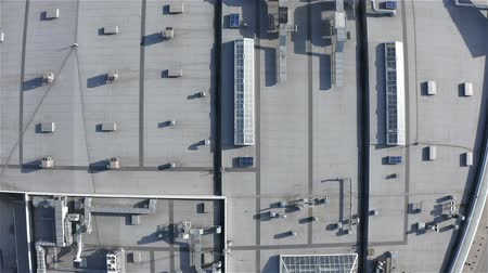 refrigerant : aerial survey of the roof of an industrial building with light tunnel structures.