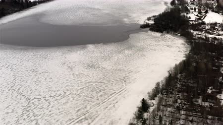 frozen lake with ice thaw. Wideo