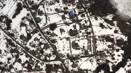 top view over the randomness of the structure of houses in the village. Wideo