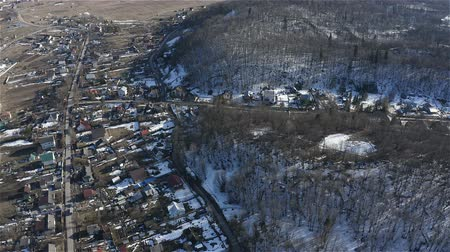hearth : View of the cottage village at the foot of the mountain. Winter. Aerial survey. Stock Footage