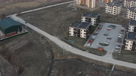 tracking from the air for a car moving in the residential area. Stock mozgókép