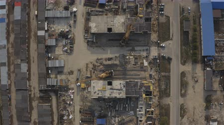 flying around a large construction site of a residential area on a new land territory.