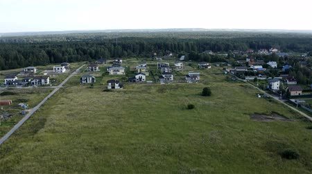 architecture and urbanism : village with low houses near the forest.