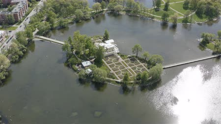 pavilion : Russia, Peterhof May 19, 2019 top view of a small island in the middle of a lake. Tsaritsyn island
