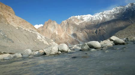 gilgit baltistan : Flowing water stream that melt from the glacier, among the Karakoram mountain range in Passu, Gilgit Baltistan, Pakistan. Stock Footage