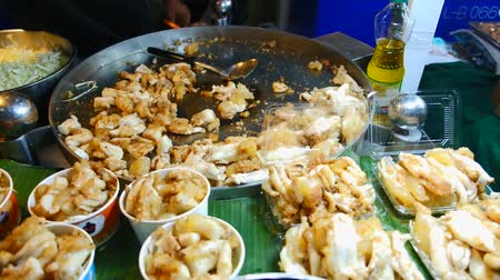 kalmar : Asian street food, stir-fried squid eggs freshly cooked for sale in a local market in Bangkok, Thailand.