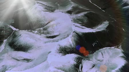 icy : a birds-eye view of snow mountain plateau,sunlight & solar flare.