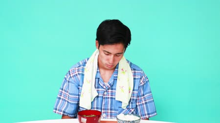 vomit : Portrait of Asian man no appetite while having foods.