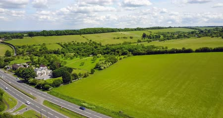 otoyol : Aerial view of sittingbourne and maidstone road  dual carriageway with green fields and blue sky in the background, Kent, England, UK