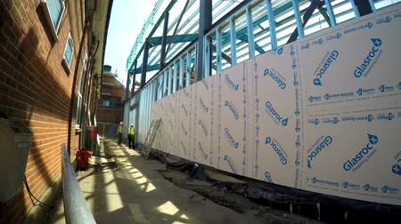 スタッド : Taping and jointing the jumbo stud drywall at construction site of recycle centre timelapse