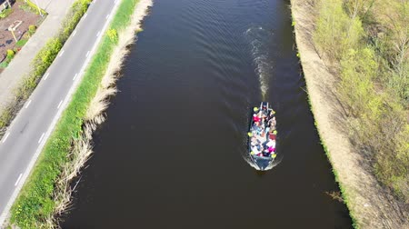 cyclist : Aerial view of a boat in the canal, Holland Stock Footage