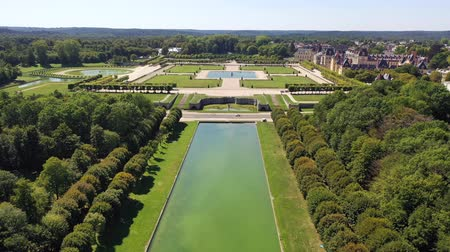 surroundings : Aerial view of medieval landmark royal hunting castle Fontainbleau and lake with white swans, France