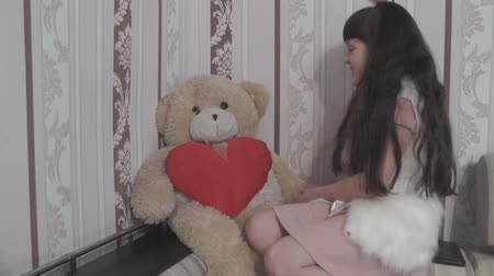maci : The girl approaches the bear and greets him