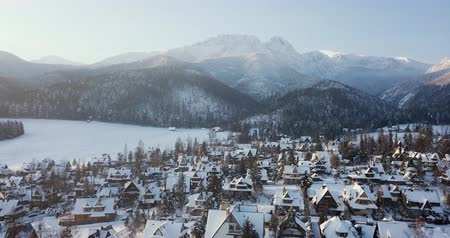 buried : Cinematic view of the mountains and the small town Stock Footage