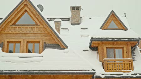 felvidéki : wooden highlander house in the mountains during an intense snowstorm