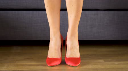 high heel shoe : Woman walks sensually in red high heels showing sexy and slim long legs
