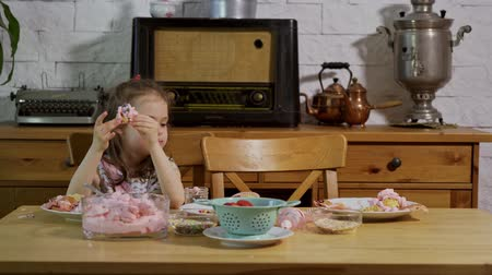 vdolky : little girl decorates and eats delicious cupcakes