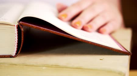 referência : view of a womans hand reading an old book on a table Stock Footage