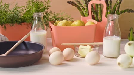 chives : Spring young vegetables with eggs and with milk and  frying pan on  wooden table