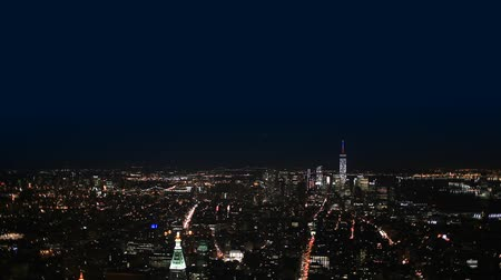 night scene : Aerial View New York City, Manhattan Cityscape by night. Stock Footage