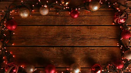 Christmas decoration frame with balls and lights on wooden table. Vídeos
