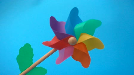 Colorful Pinwheel turns on a light blue background.