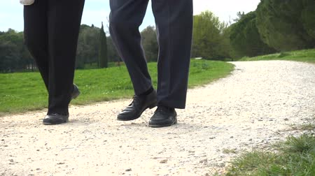 Close up of the legs of a couple walking in the park