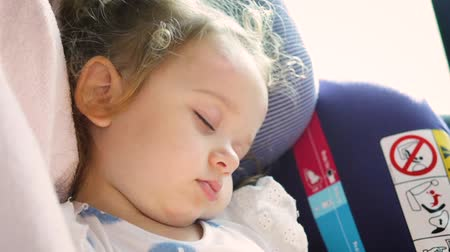 Cute blond baby sleeping in baby car seat. Safety Concept. Vídeos
