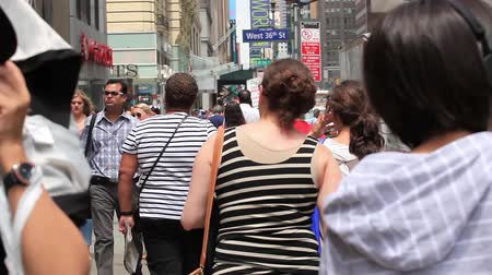 New York City, USA - July 08, 2015: Walking through the crowd. Manhattan is the most densely populated borough of New York City.