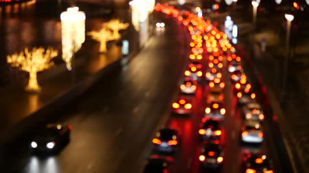Traffic jam on a highway at night, out of focus