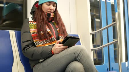 commute : Young woman read e-book in subway train at metro Stock Footage