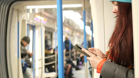 ebook : Young woman read e-book in subway train at metro Stock Footage