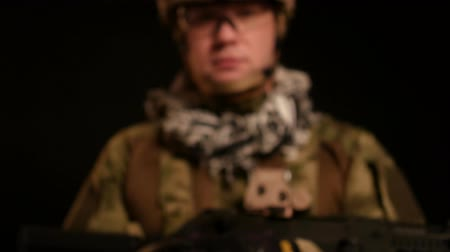 Portrait of military man. Dark key. Footage with camera motion.