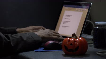 bloody : Hand typing keyboard in halloween night