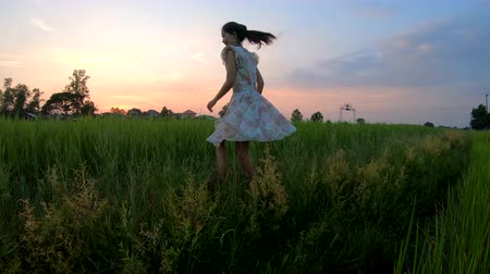 ジャスミン : Beautiful girl running slow motion in the rice field at sunset 動画素材