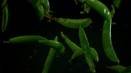 foods : Green peas pouring slow motion