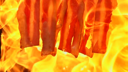 slanina : Grilling bacon slow motion on black background