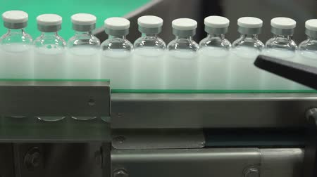pharmaceuticals : Bottles with drugs on the conveyor line in pharmaceutical factory