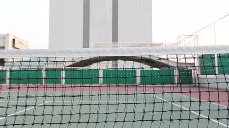 tennis stadium : Tennis court with net tracking left Stock Footage