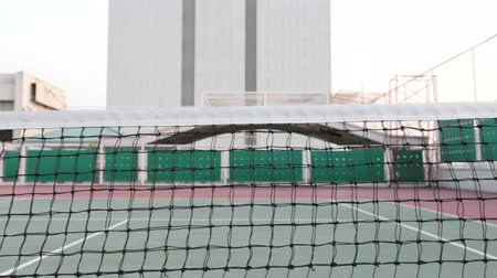 tennis stadium : Tennis court with net tracking right