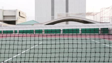 tennis stadium : Tennis court with net tracking right and up and focus at net