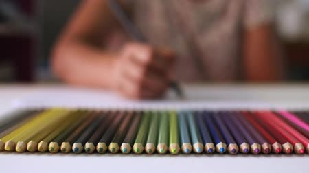 crayon : Female designer is drawing with colored pencils on the desk, Selective focus.