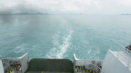 bum : View from rear side of a ferry is traveling on the sea heading to the island.