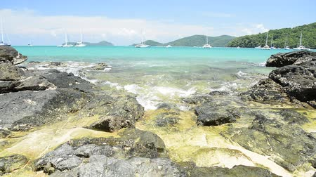 breezy : Scenery of Ao Yon Bay in andaman sea with clear water and yachts during summer in phuket, Thailand. Stock Footage