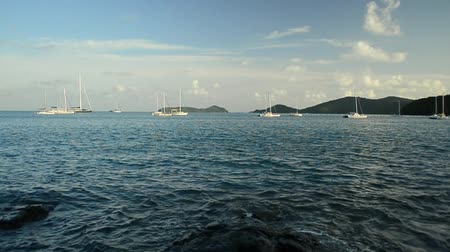 sail rock : Scenery of Ao Yon Bay in andaman sea with yachts under cloudy blue sky in phuket, Thailand.