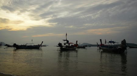 moor : Scenery of Rawai beach during sunrise with many long tail boat in the andaman sea, Phuket, Thailand.