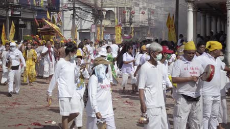 merito : PHUKET- OCT 06 : Taoism participants in a street procession of the Phuket Vegetarian Festival on Oct 06, 2019 in Phuket, Thailand. During festival devotees abstain eating meat to appease the God. Filmati Stock