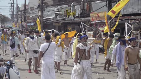 repentance : PHUKET- OCT 06 : Taoism participants in a street procession of the Phuket Vegetarian Festival on Oct 06, 2019 in Phuket, Thailand. During festival devotees abstain eating meat to appease the God. Stock Footage