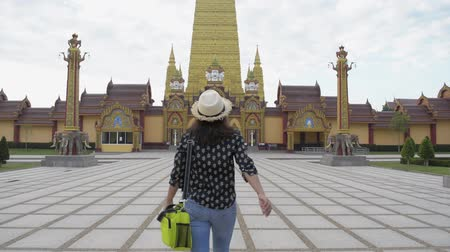 Asian woman tourist walking in the buddhist temple and admire to see a great pagoda. Bang Thong Temple is one of the most famous and beautiful theravada buddhist temple in thailand.