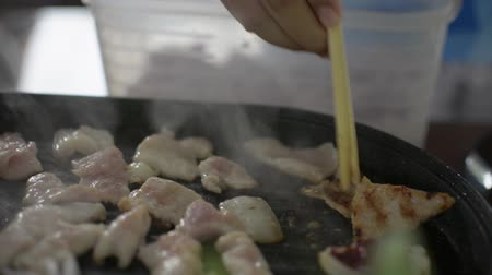 kalmar : Raw pork and squid being grill in the pan. Cooking meat. Meal time. Dostupné videozáznamy